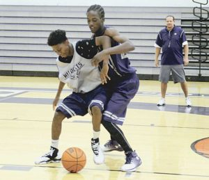 Staff photo: Tony Bullocks Clovis High junior guard Nate Lewis, front, battles to keep the ball from senior forward Leroy Wilson during a drill last week at Wildcats practice at Rock Staubus Gym. The Cats open the season on Saturday night at defending Class 6A state champion Rio Rancho.