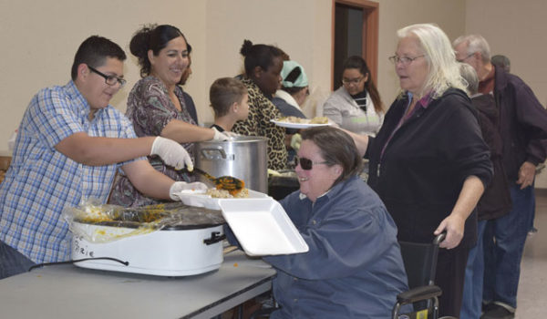 Portales community gathers for meal
